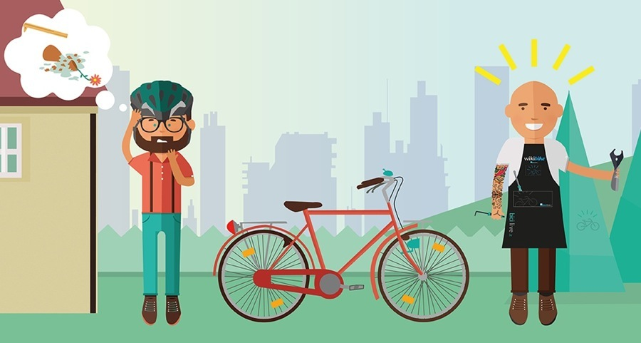 La foto mostra un papà in difficoltà per il montaggio del seggiolino bici. Se non si è pratici nel montare il seggiolino è meglio rivolgersi ad un negozio specializzato
