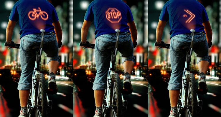 Una foto con le segnalazioni proiettate da cyclee sulla schiena del ciclista