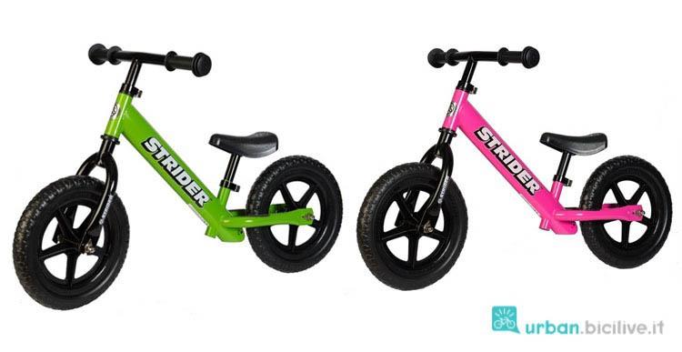 Le bici senza pedali di Strider, in versione verde per bambiono e fukia per bambina