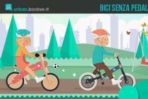 Nell'immagine due bambini che giocano sulla loro bici senza pedali, chiamata anche balance bike o push bike.