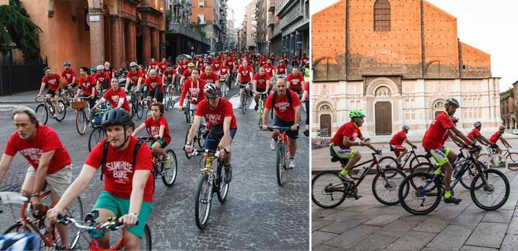gruppi numerosi di ciclisti pedalano durante una passata edizione di sunrise bike ride