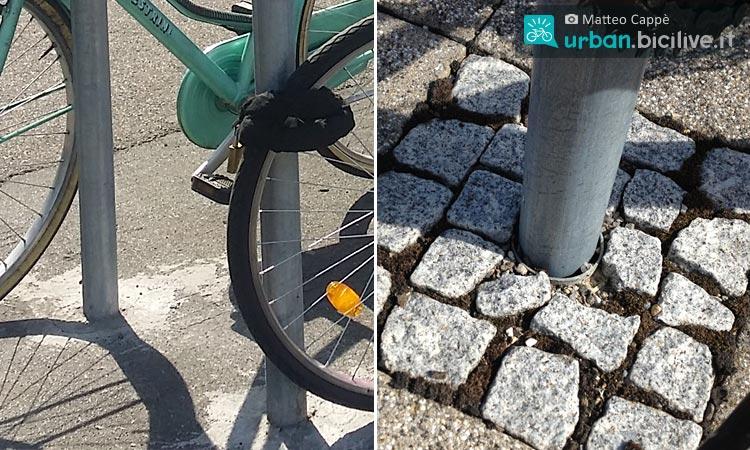 delle bici legate a un palo con catene e altri antifurto