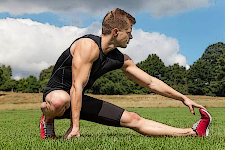 Un atleta impegnato a tirarsi i muscoli della gamba